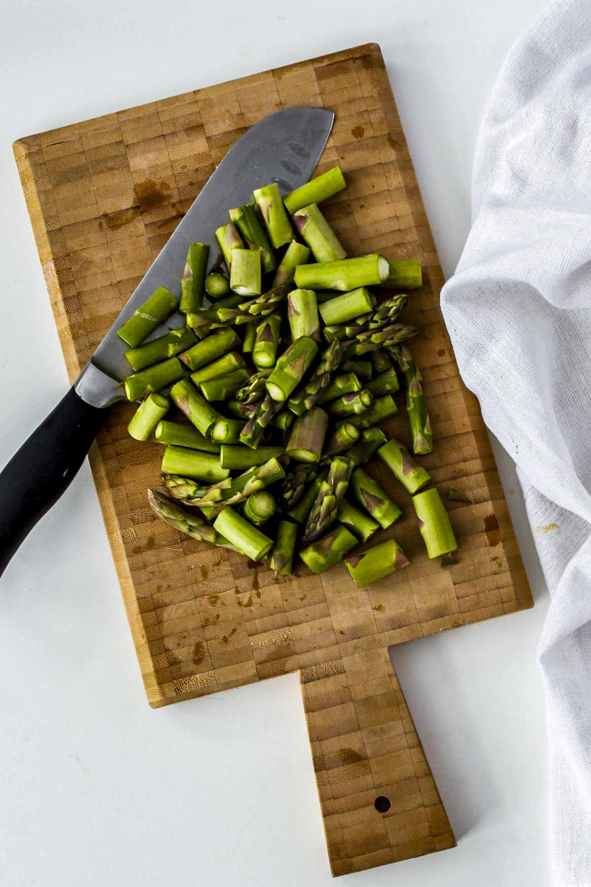 Asparagus cut on a cutting board.