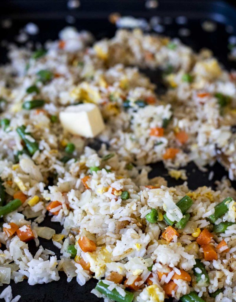 fried rice with butter being added