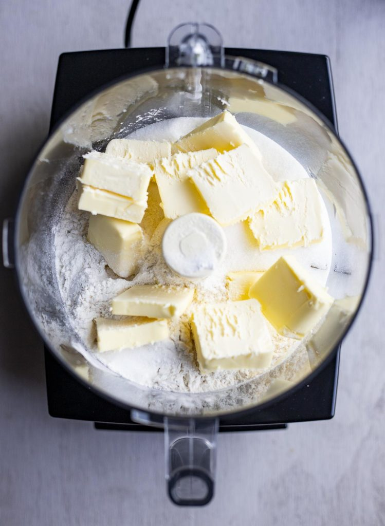 butter and flour in a food processor bowl