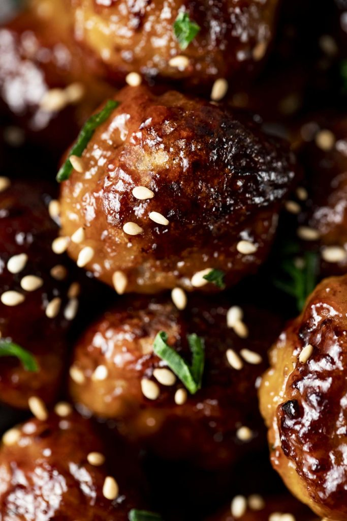 cooked meatballs with sesame seeds and green onions