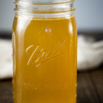 golden broth in a mason jar