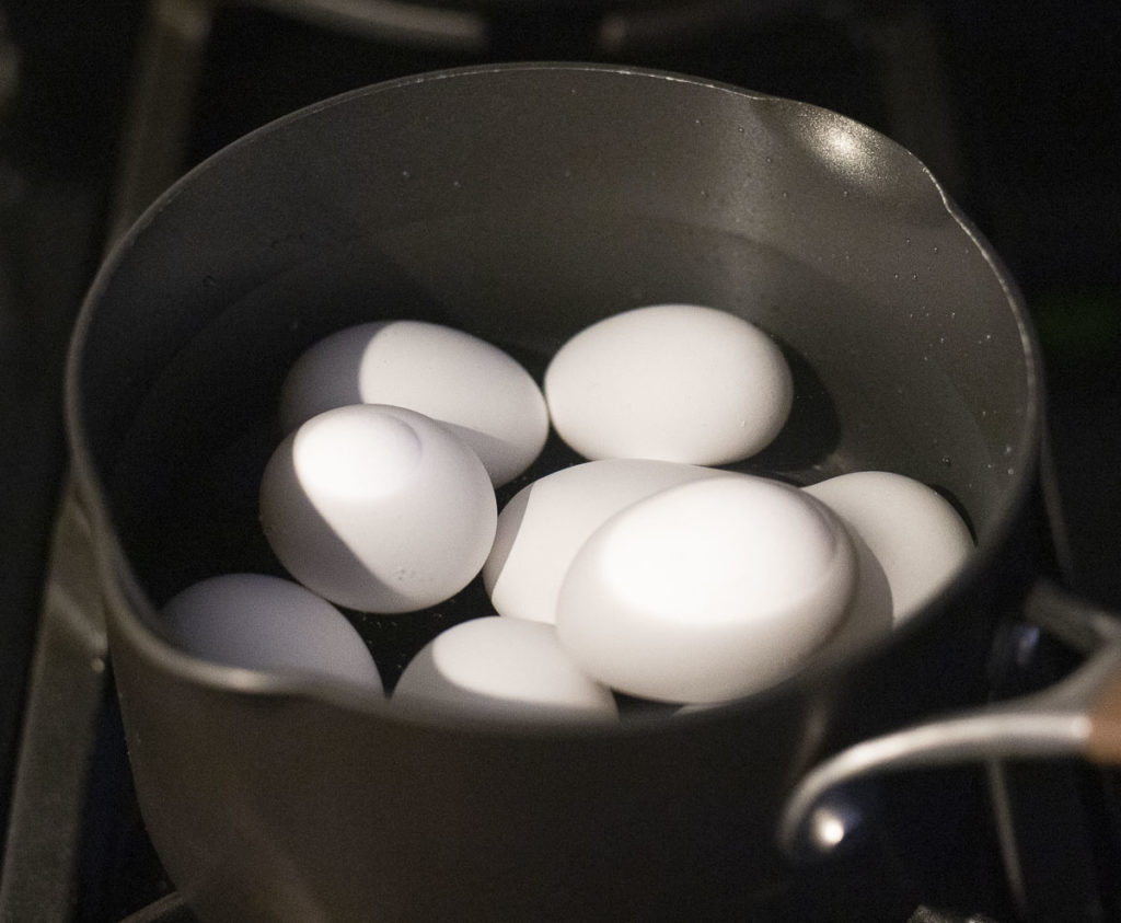 eggs in a pot covered with water