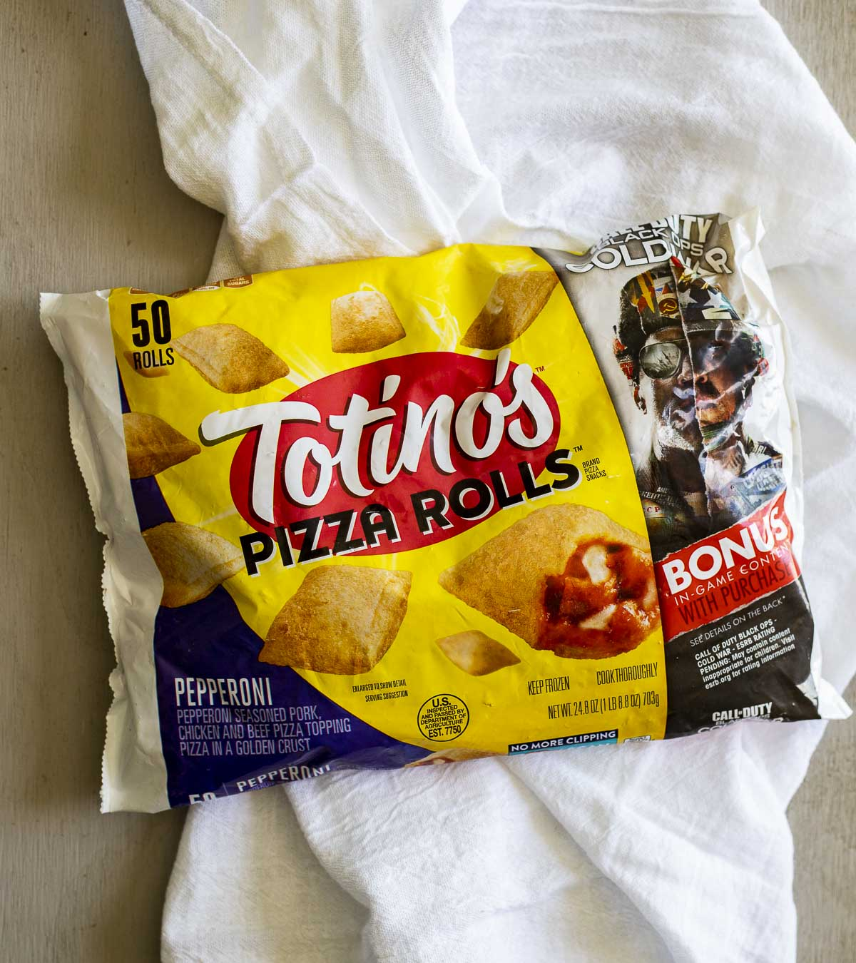 A bag of frozen Totino's pizza rolls.