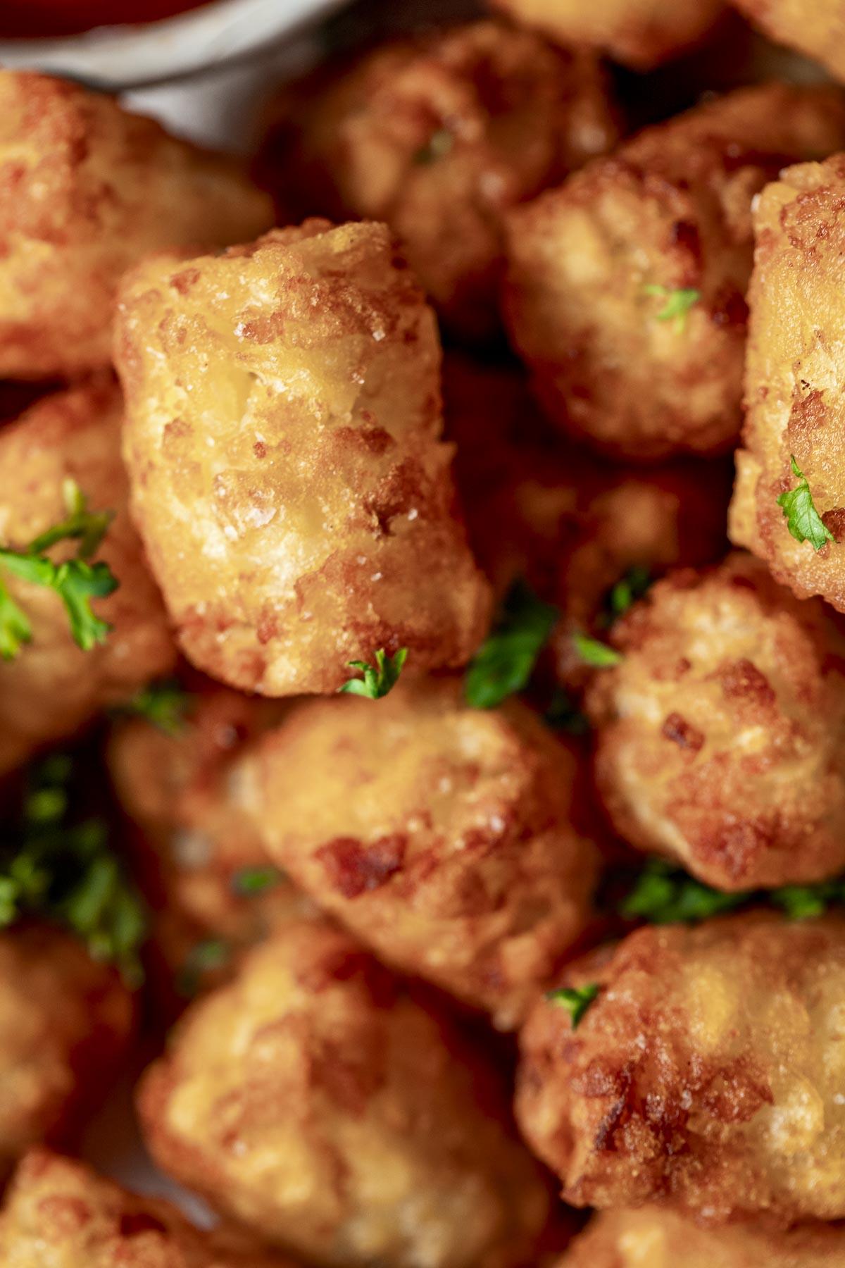 Close up of crispy air fryer tater tots.