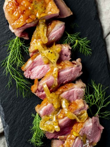 Duck breasts with orange glaze on top.
