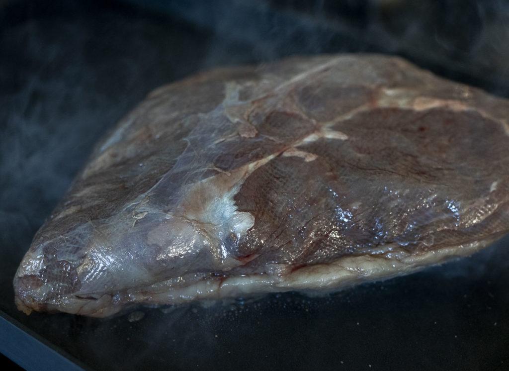 Searing steak, fat cap down.