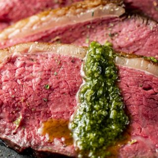 Close up of a perfectly cooked slice of picanha steak.