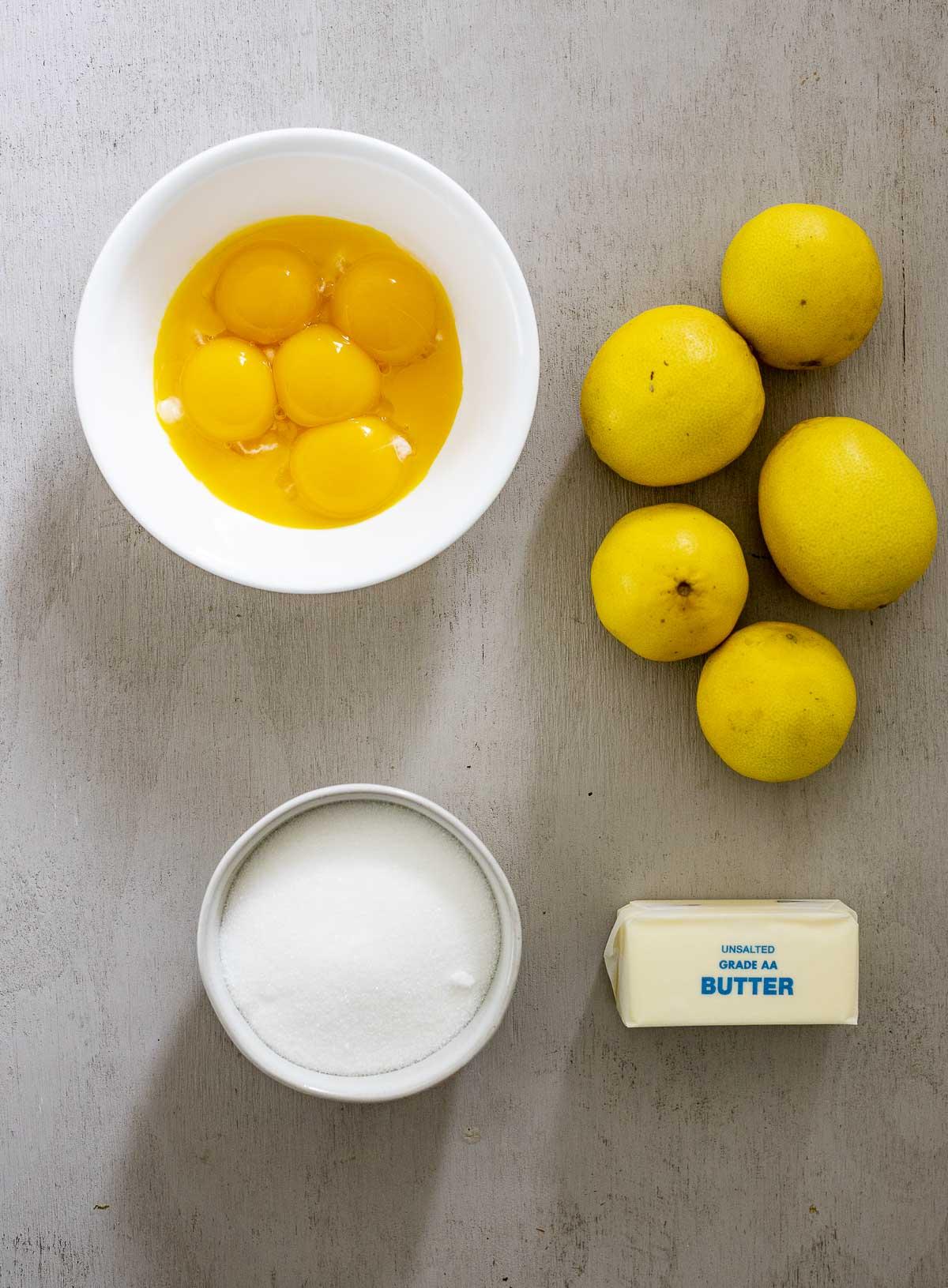 Ingredients needed to make lemon curd.