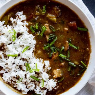 Instant Pot gumbo with chicken and sausage in a bowl and topped with rice.