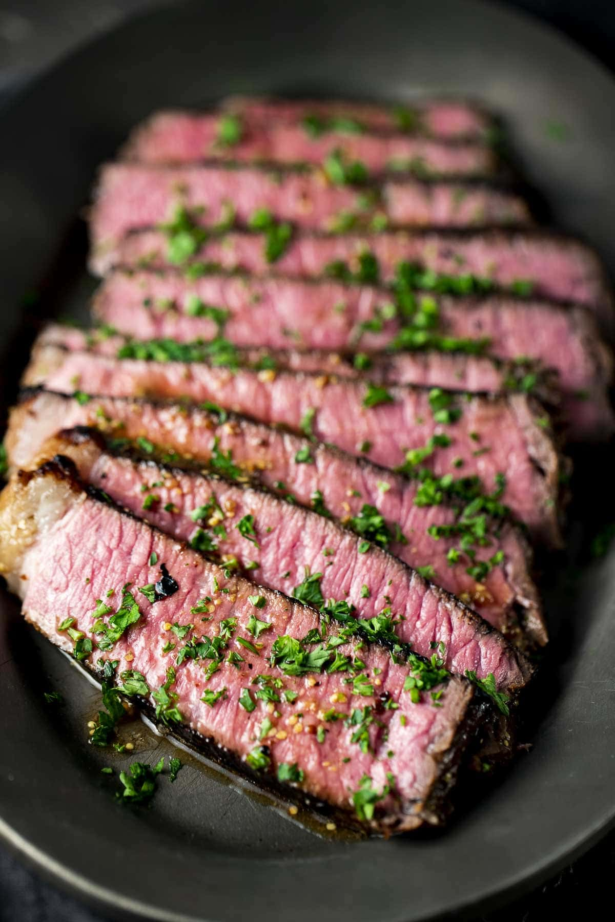 Medium-rare steak cooked sous vide style and sliced.