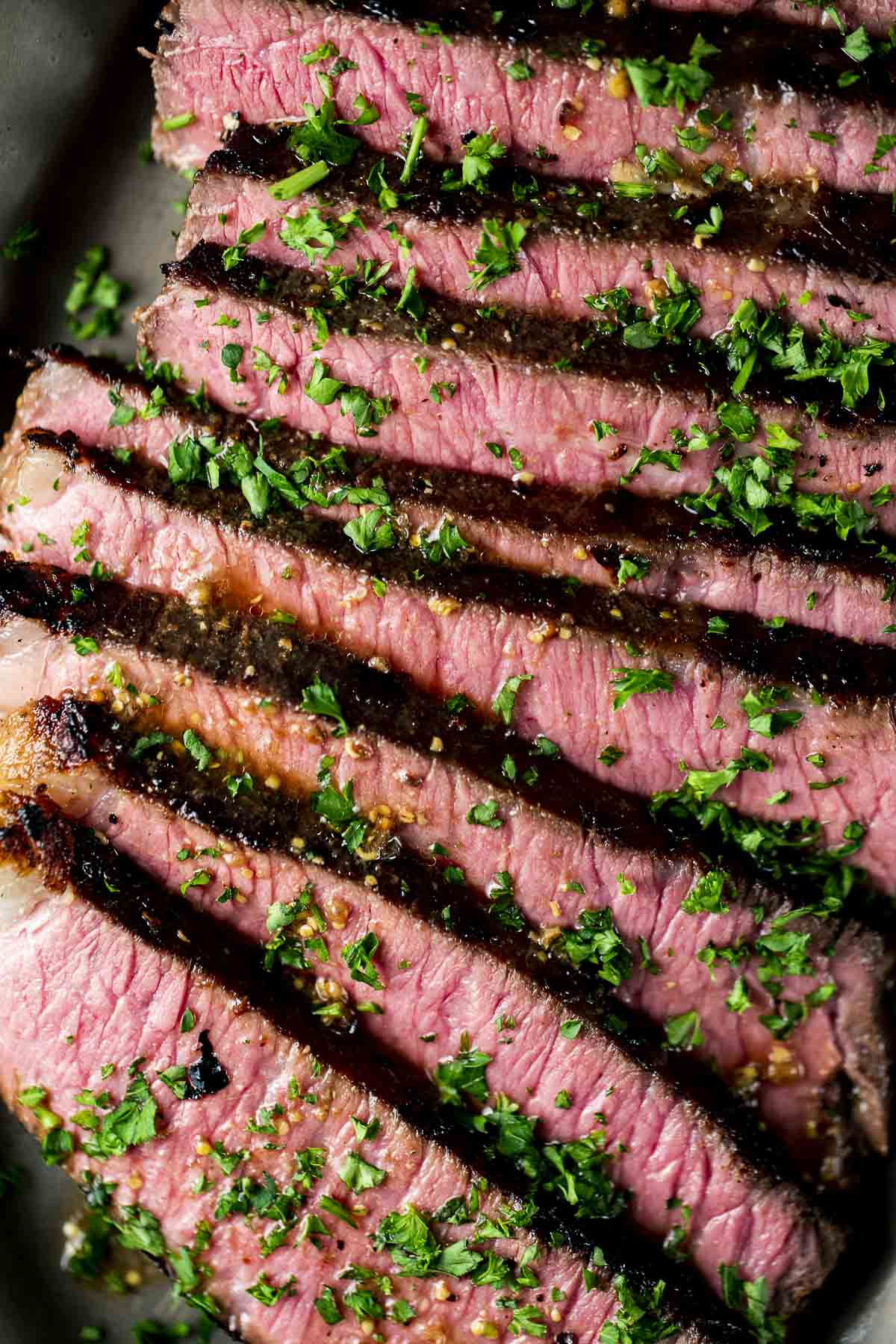 Up close of a London broil cooked to medium rare and sliced.