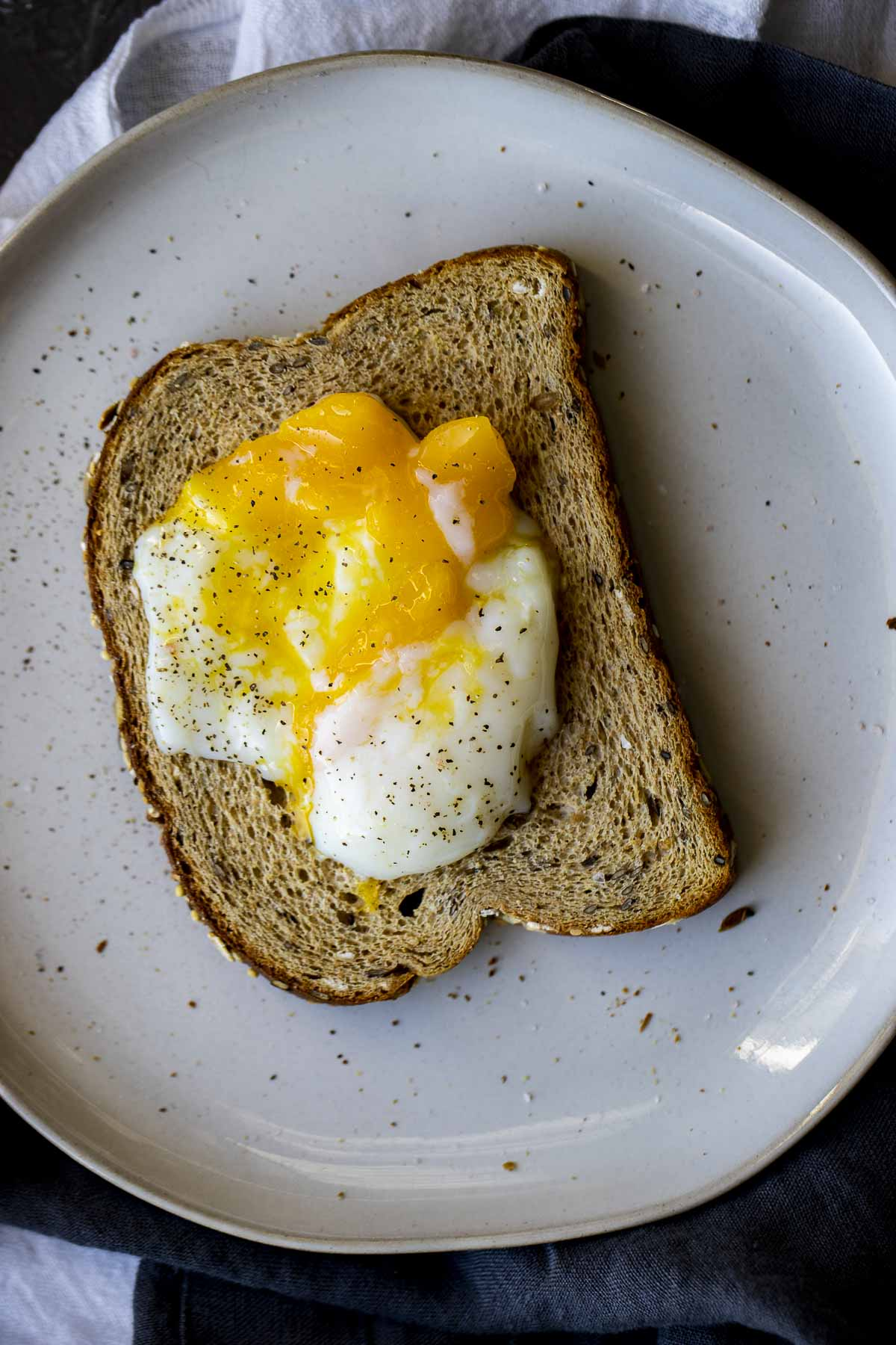 Poached egg over toasted bread.