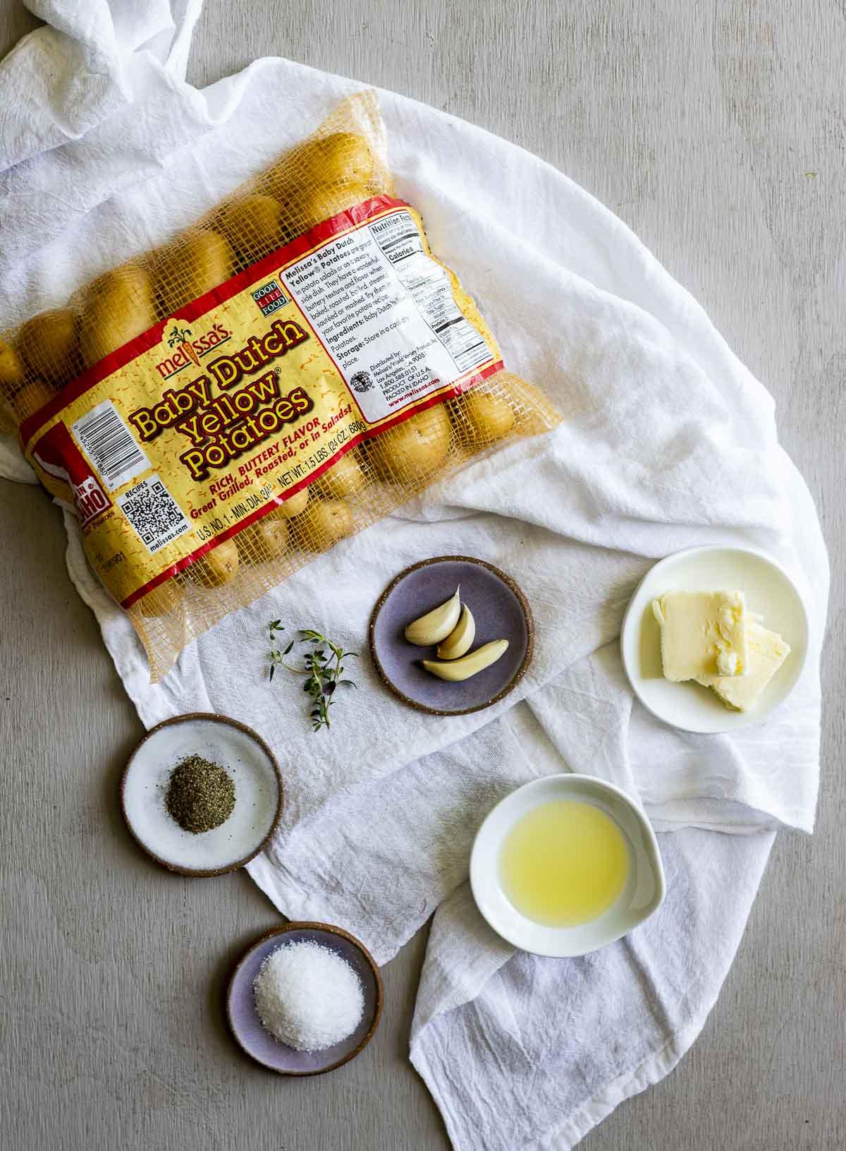 Ingredients to make sous vide potatoes arranged individually.