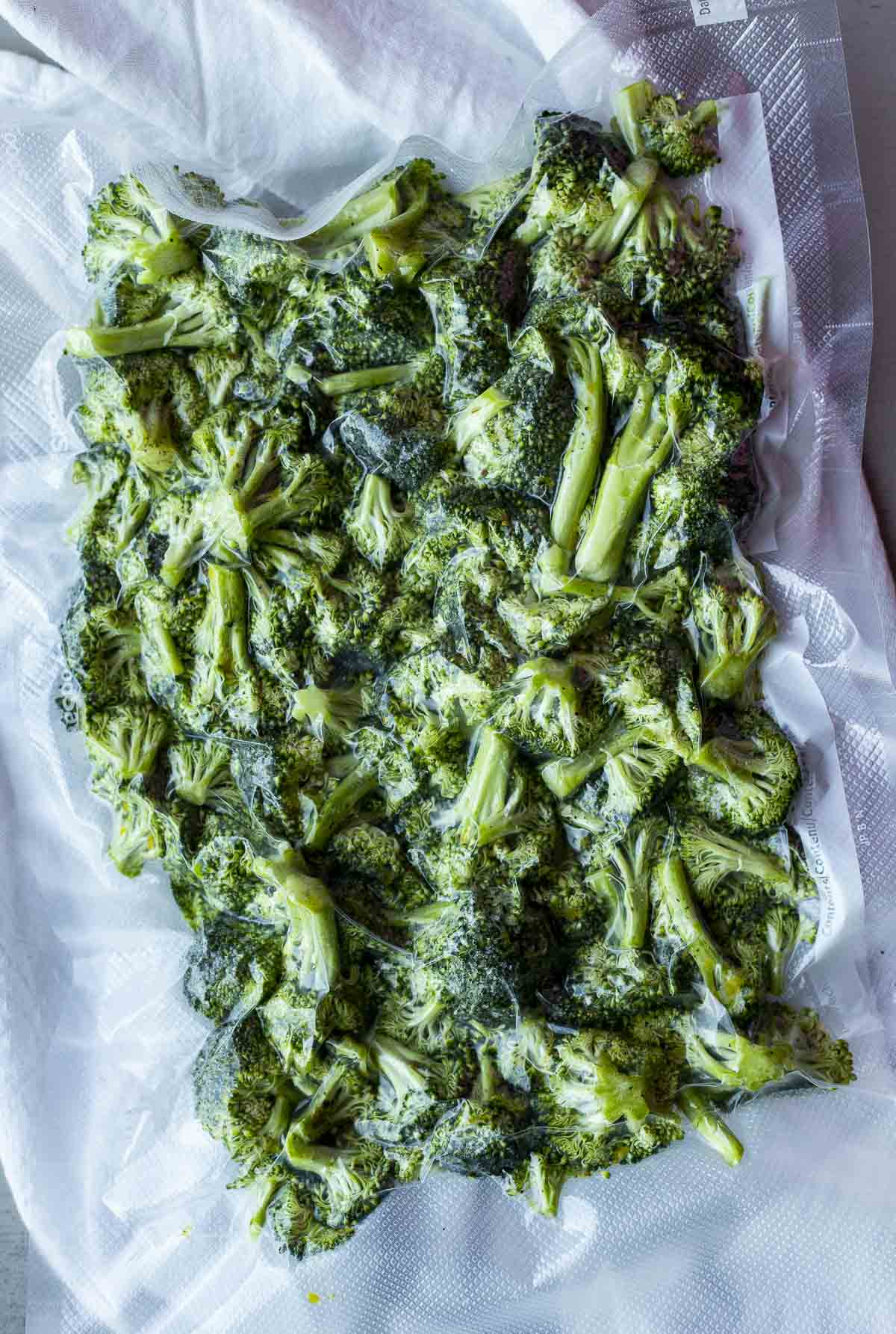 Broccoli vacuum sealed in a sealable bag.