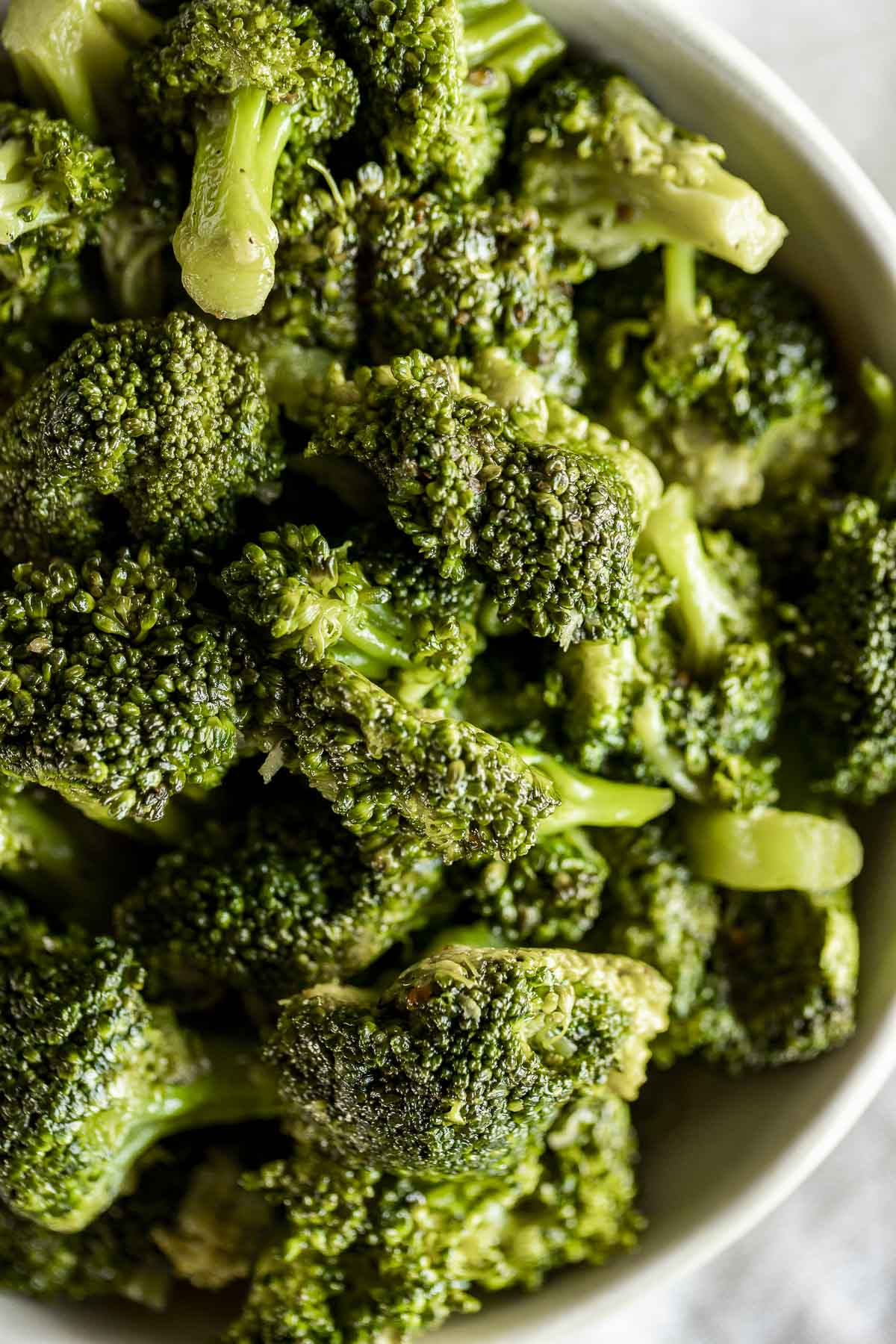 Up close of sous vide broccoli florets in a whole.