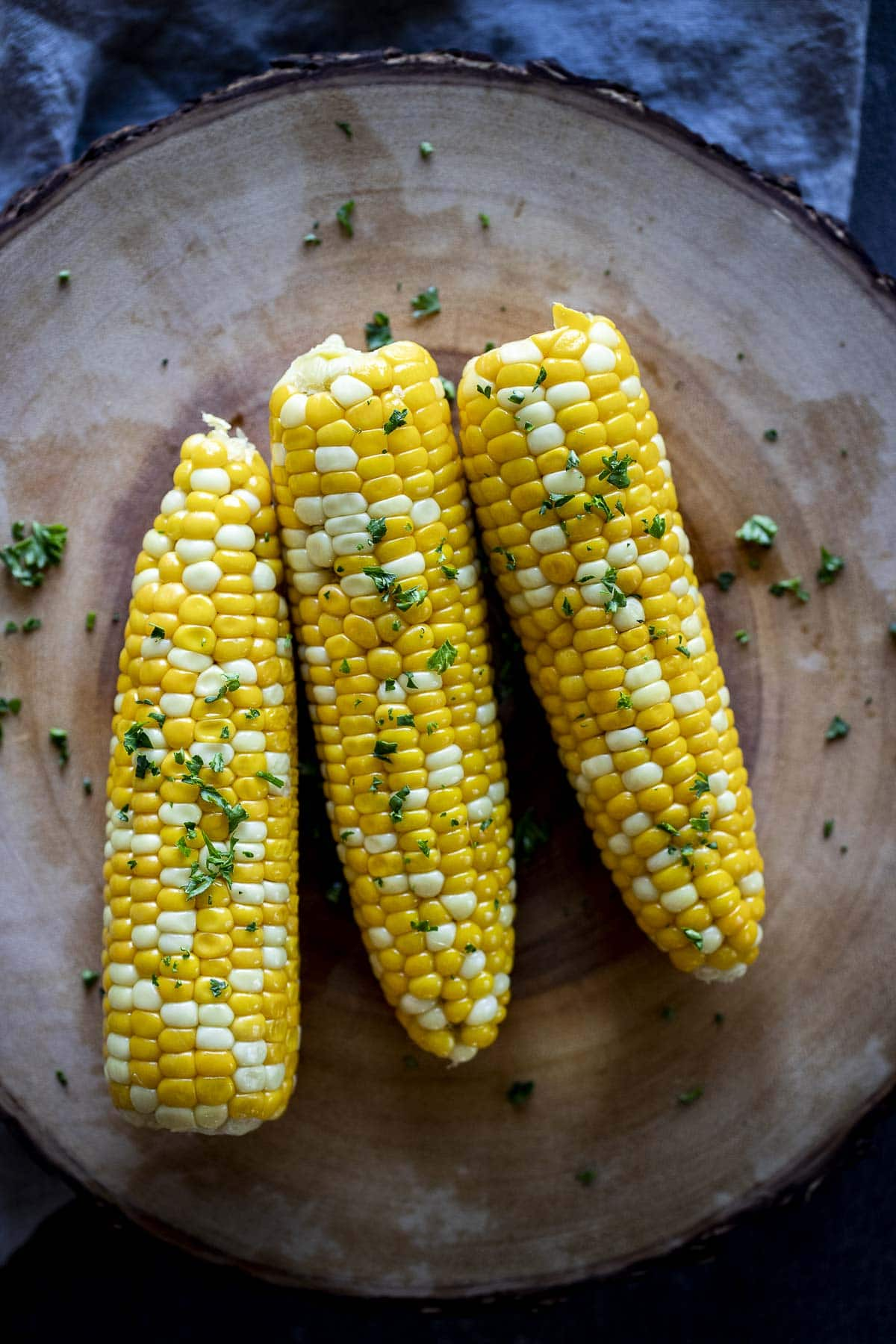 Overhead view of three ears of sous vide corn on the cob.