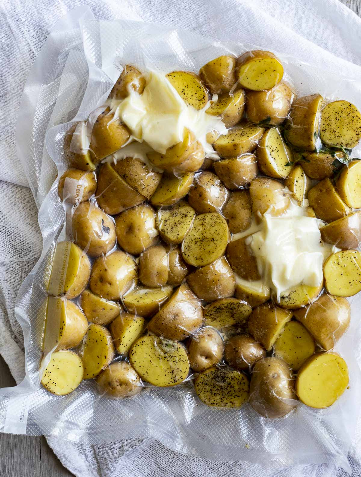 Mini potatoes vacuum sealed in a bag with seasoning and butter.