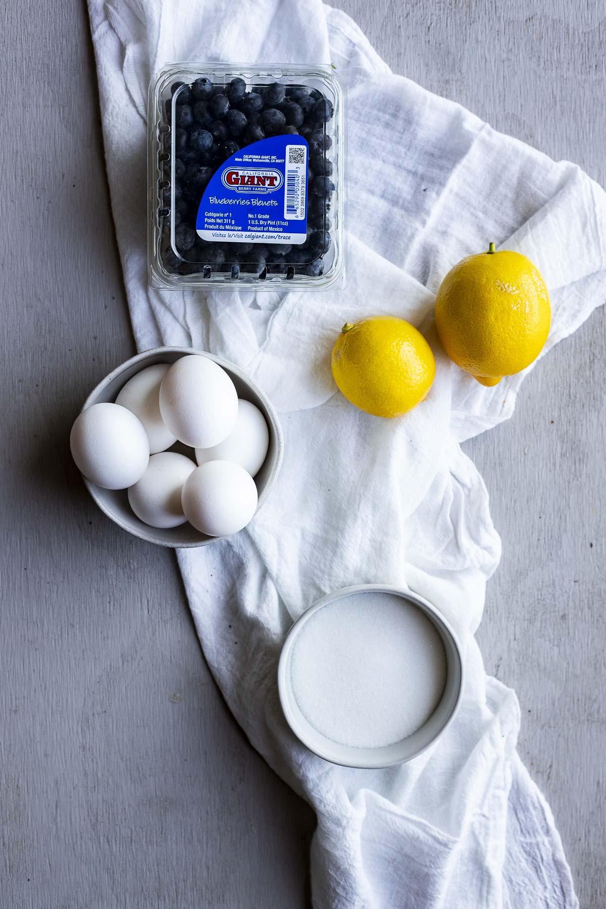 Ingredients to make blueberry lemon curd arranged individually.