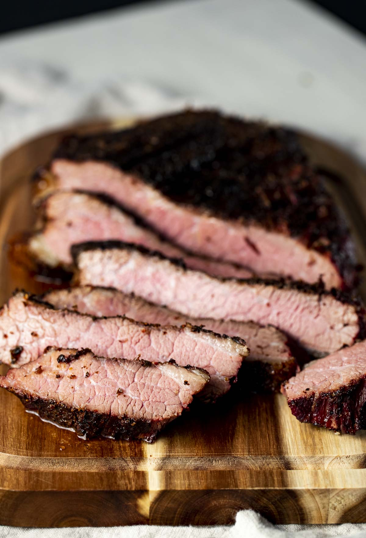 Side view of sous vide brisket carved into slices.