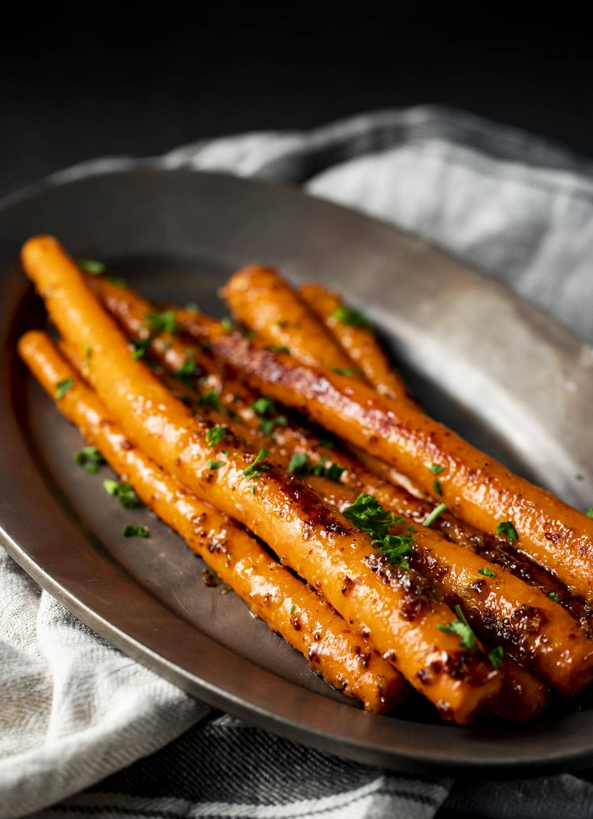 Sous vide carrots on a serving tray.