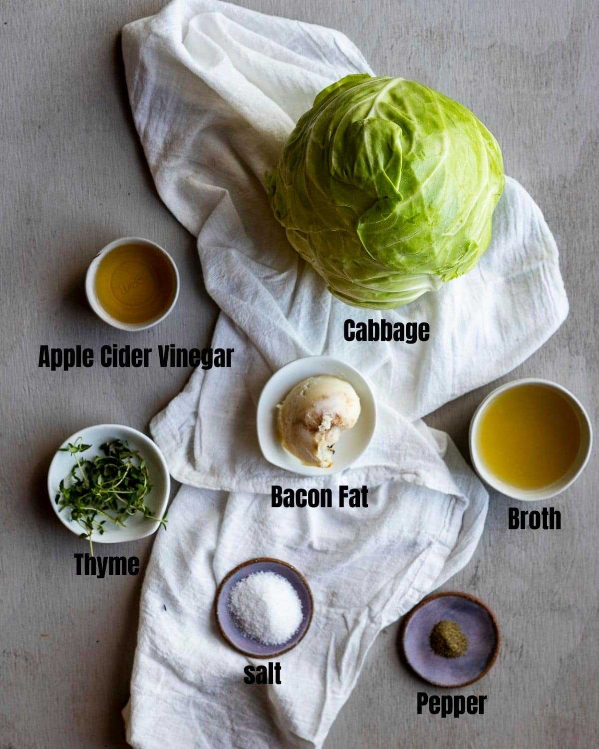 Ingredients to make Instant Pot cabbage arranged individually and labelled.