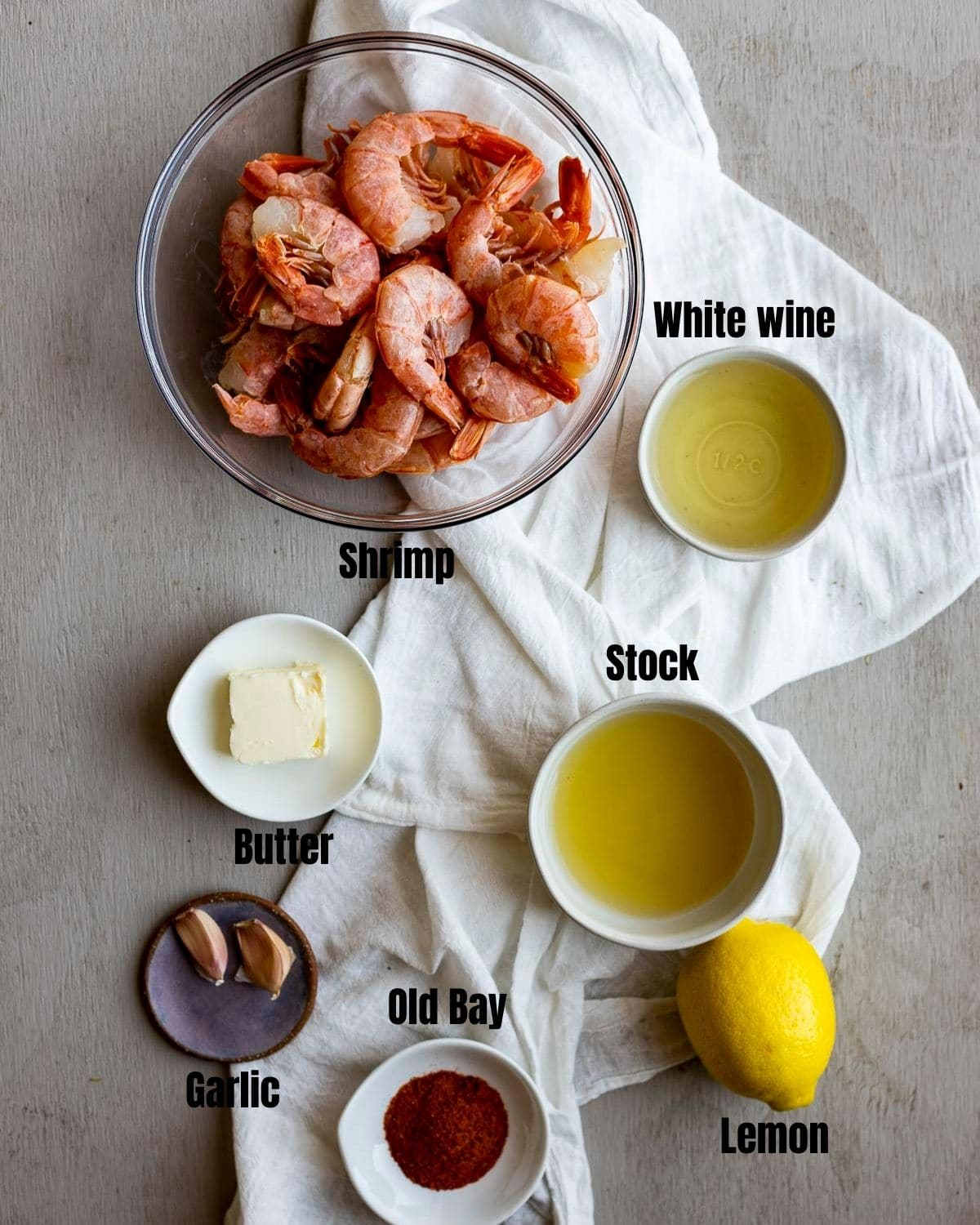 Ingredients to make Instant Pot shrimp arranged individually and labelled.