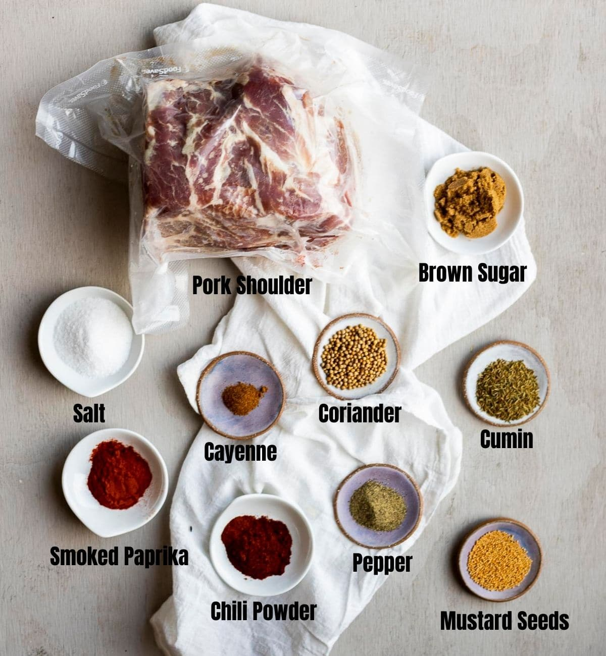 Ingredients to make sous vide pulled pork arranged individually and labelled.