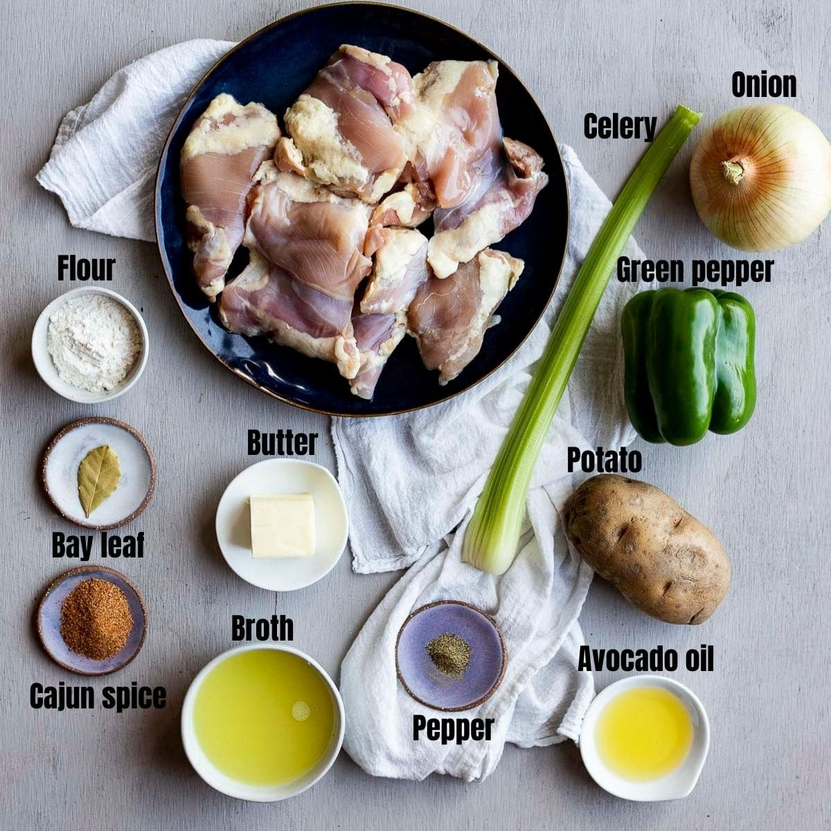 Ingredients for southern stewed chicken arranged individually and labelled.