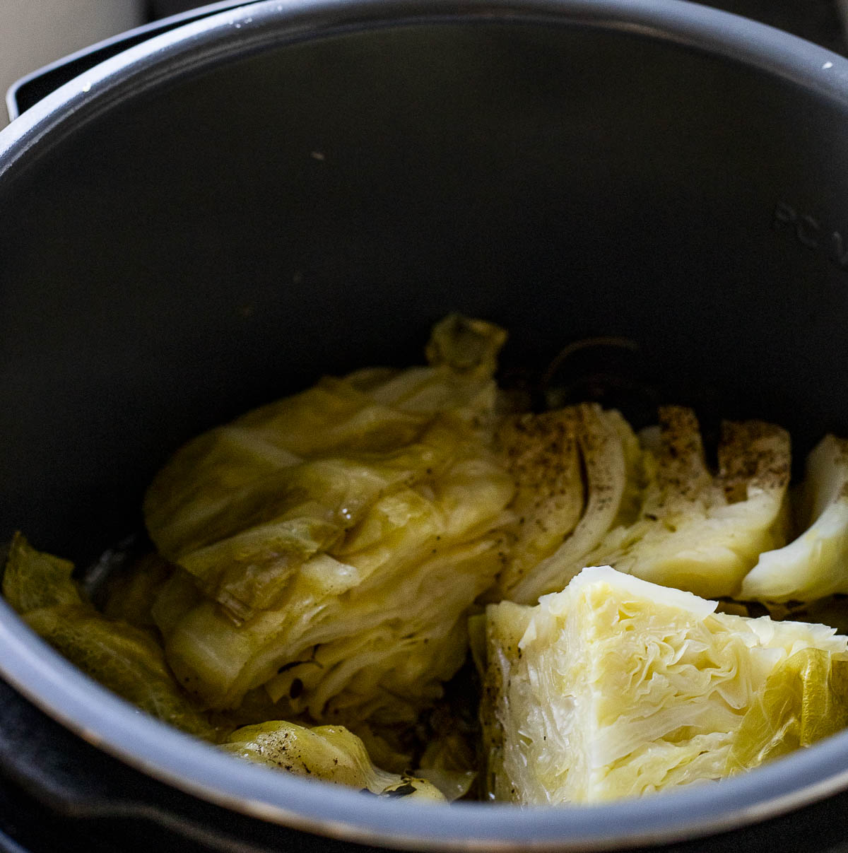 Cooked cabbage pieces in the Instant Pot.
