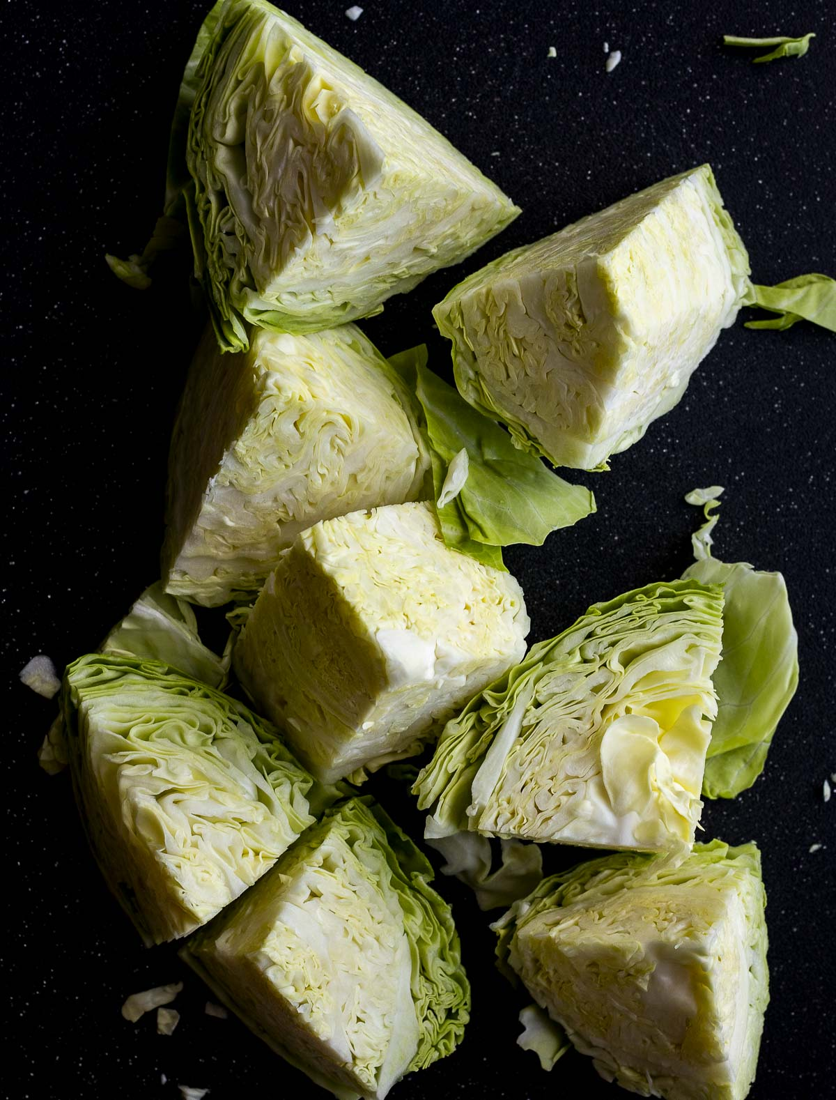 Head of cabbage cut into 8 pieces.