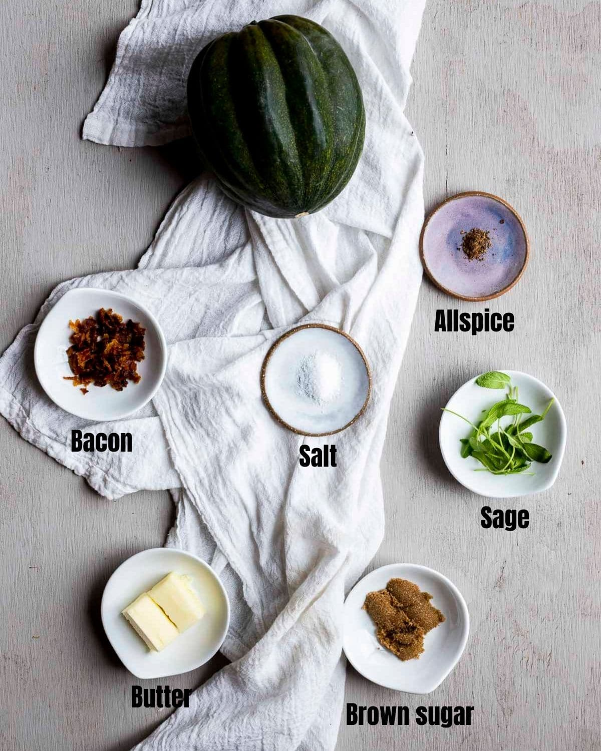Ingredients to make air fryer acorn squash arranged individually and labelled.