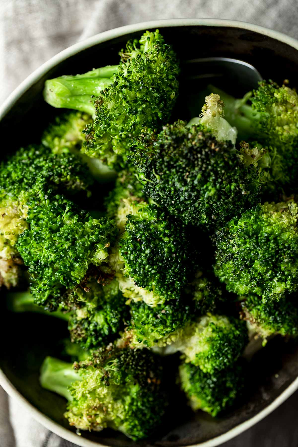 Overhead close up of air fryer roasted broccoli.