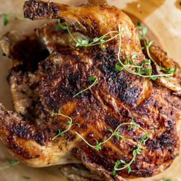 Overhead view of a whole cooked chicken with crispy skin.