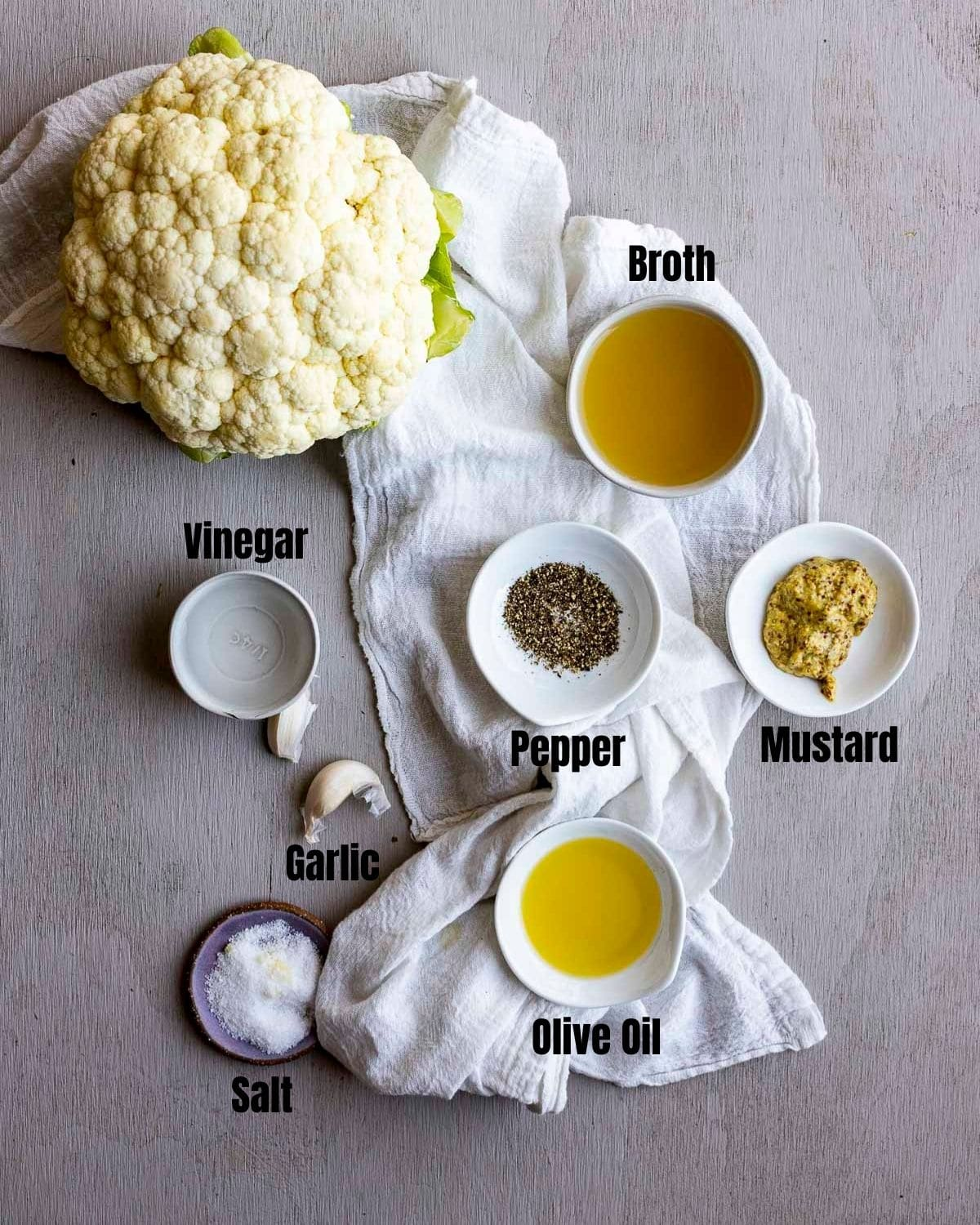 Ingredients to make Instant Pot cauliflower arranged individually and labelled.