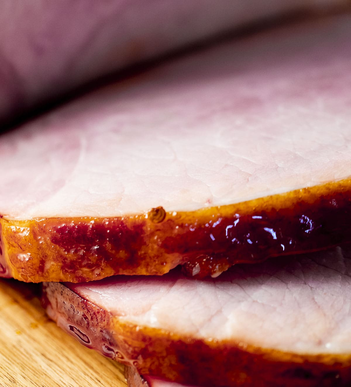 Close up view of ham slices with glaze.