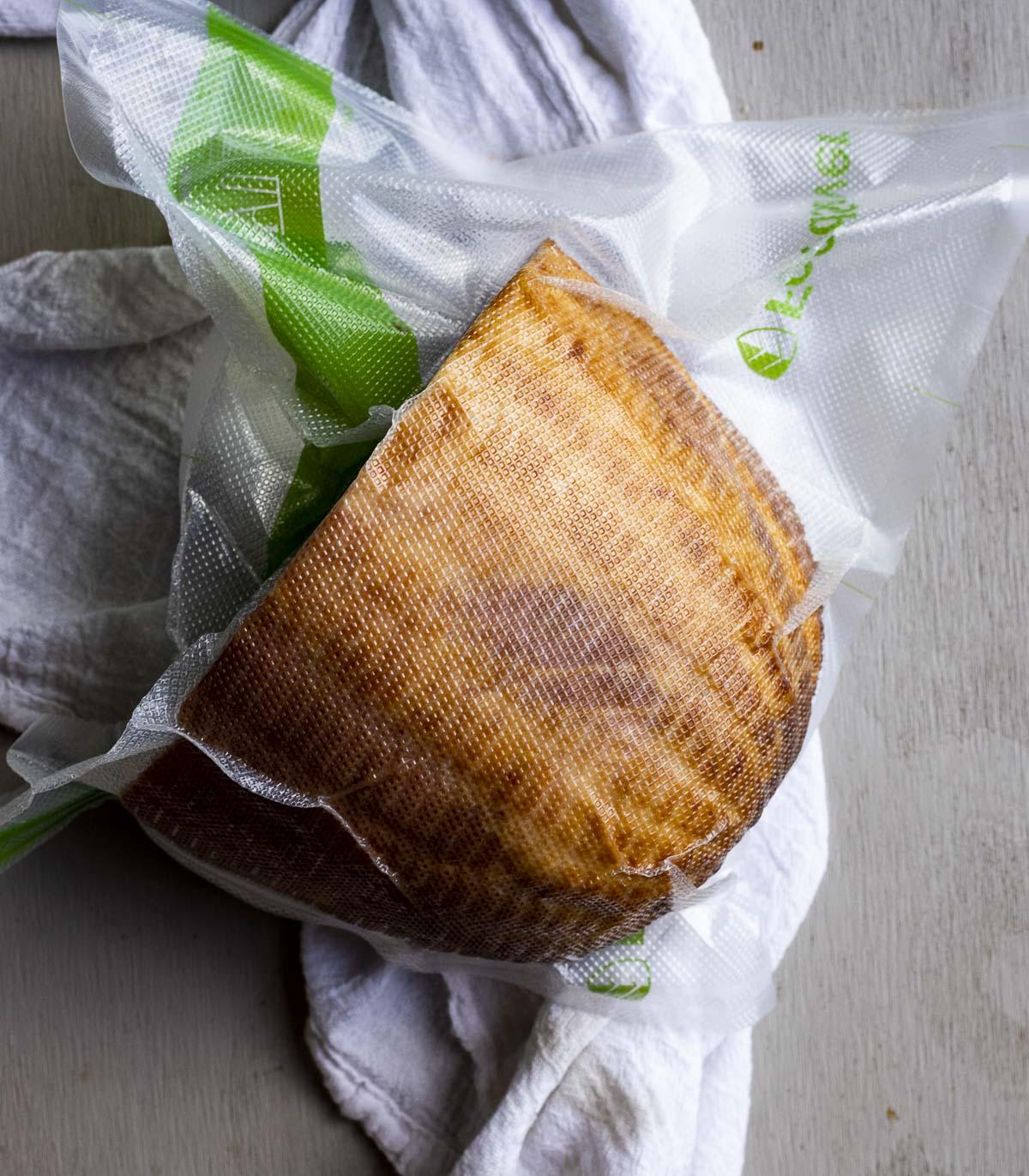 Boneless ham vacuumed sealed in a bag.